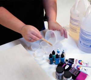 Pour the mixed resin into mini-cups and save some clear resin aside.