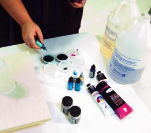 Add your pigment of choice to each mini cup and mix well. Start with just a few drops of pigment until you get the color you desire.