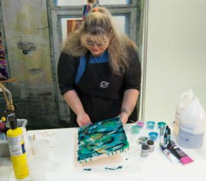 Tilt the ground or use a pallet knife to encourage color flow if you would like.
