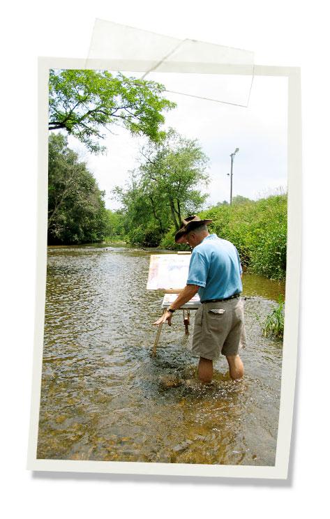 Joe painting in water