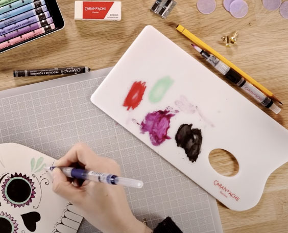 Artist Drawing with Neocolor Crayons using Neocolor Mixing Palette